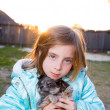 Blond children kid girl playing with puppy dog chihuahua — Stock Photo