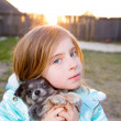 Stock Photo: Blond children kid girl playing with puppy dog chihuahua