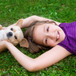 Children kid girl playing with puppy dog chihuahua — Stockfoto