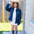 Royalty-Free Stock Photo: Little kid girl pretending to be a cowboy