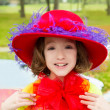 Funny little girl with fashion red hat and tulle bow — Stock Photo #26183277