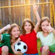 Stock Photo: Three sister girls friends soccer football winner players