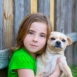 Blond happy girl with her chihuahua doggy portrait — Stock Photo