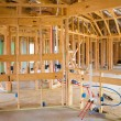 Stock Photo: Americresidential wooden house contruction