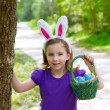Easter girl with eggs basket and funny bunny ears — Stock Photo