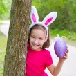 Easter girl with big purple egg and funny bunny ears — Stock Photo