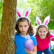 Easter girls playing on forest with bunny teeth gesture — Stock Photo