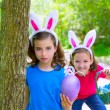 Easter girls playing on forest with bunny teeth gesture — Stock Photo #26185091