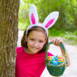 Easter girl with eggs basket and funny bunny face — Stock Photo #26185151