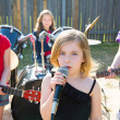 Chidren singer girl singing playing live band in backyard — Stock Photo #26187653