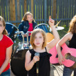Chidren singer girl singing playing live band in backyard — Stock Photo