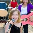 Chidren singer girl singing playing live band in backyard — Stock Photo #26187991