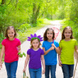 Friends and sister girls walking outdoor in forest track — Stock Photo