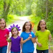 Stock Photo: Friends and sister girls walking outdoor in forest track