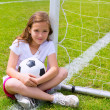 Soccer football kid girl relaxed on grass with ball — Stock Photo