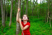 Happy girl playing in forest park jungle with liana — Stock Photo