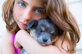 Girl hug a little puppy dog gray hairy chihuahua — Stock Photo
