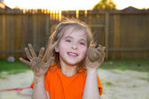 Children girl playing with mud sand ball and dirty hands — Stock Photo