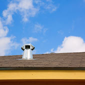 Blue roof skylight window chimney — Stock Photo