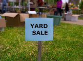 Yard sale in an american weekend on the lawn — Stock Photo