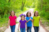 Friends and sister girls walking outdoor in forest track — Stok fotoğraf