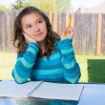 American latin teen girl doing homework on backyard — Stock Photo #26190259