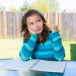 Royalty-Free Stock Photo: American latin teen girl doing homework on backyard