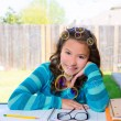 Stock Photo: Americlatin teen girl doing homework on backyard