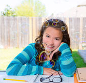 American latin teen girl doing homework on backyard — Stock Photo