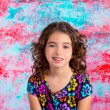 Bunette kid girl portrait smiling in grunge background — Stock Photo