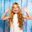 Hippie children girl excited open mouth with raised hands — Stock Photo
