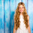 Blond happy hippie children girl smiling on blue wood — Stock Photo