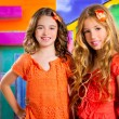 Children friends girls in vacation at tropical colorful house — Stock Photo #28273247