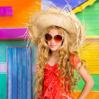 Blond children happy tourist girl beach hat and sunglasses — Stock Photo