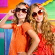 Children friends girls in vacation at tropical colorful house — Stock Photo