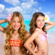 Children two friends girls happy in tropical beach vacation — Stock Photo