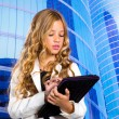 Children business student girl with tablet pc on urban buidings — Foto Stock