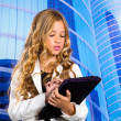 Children business student girl with tablet pc on urban buidings — Stok fotoğraf