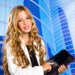 Children business student girl with tablet pc on urban buidings — Stock Photo