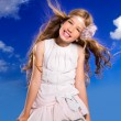 Blond girl with fashion dress blowing hair in blue sky — Stock Photo