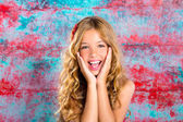 Blond kid girl happy smiling expression hands in face — Stock Photo