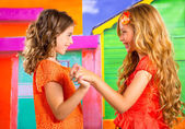 Children firends girls in vacation at tropical colorful house — Stock Photo