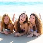 Happy three friends girls lying on beach sand smiling — Stock Photo #30637743