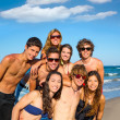 Happy teenagers young group together on beach — Stock Photo