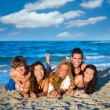 Boys and girls group having fun on the beach — Stok fotoğraf