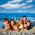 Boys and girls group having fun on the beach — Stock Photo