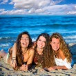 Girls friends having fun happy lying on the beach — Stock Photo #30638771