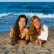 Stock Photo: Girls friends having fun happy lying on the beach