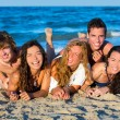 Boys and girls group having fun on the beach — Stock Photo