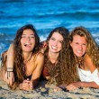 Girls friends having fun happy lying on the beach — Stock Photo